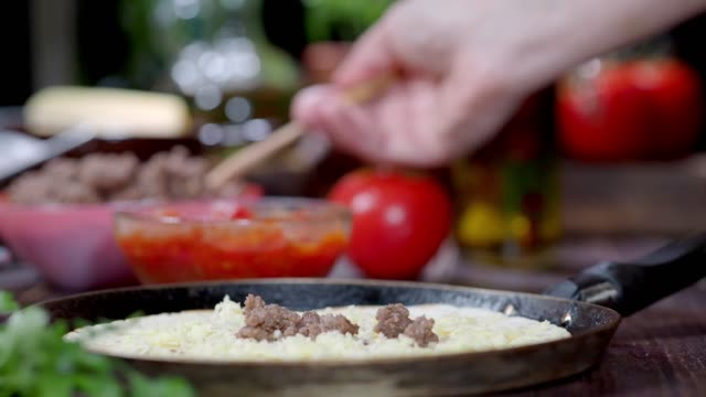 Preparing quesadilla Preparing homemade quesadilla with ground beef and salsa ground beef stock videos & royalty-free footage