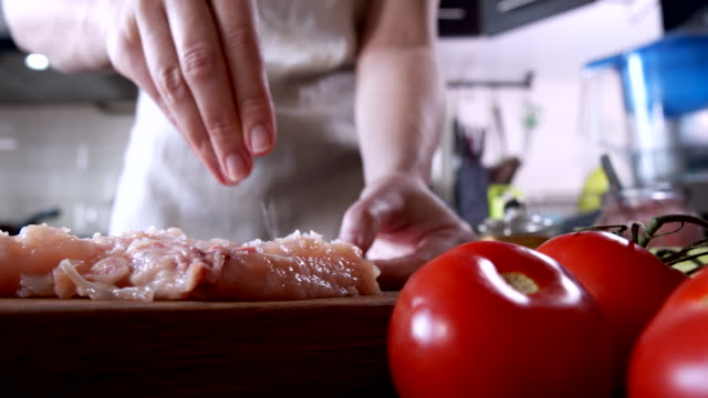 Preparing roasted chicken breast and bacon rolls served with fresh vegetables video
