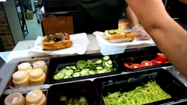 stockvideo's en b-roll-footage met preparing sandwiches (sub) in subway fast food point - sandwich