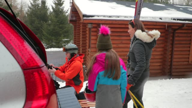 preparing to ski with her daughter - sci video stock e b–roll