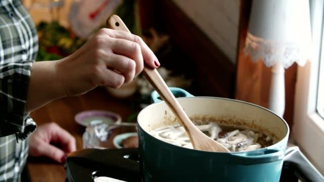 Preparing Tom Yum Goong Nam Kon Thai Soup with Shrimps, Enoki Mushrooms and Fresh Chili Preparing Tom Yum Goong Nam Kon Thai Soup with Shrimps, Enoki Mushrooms and Fresh Chili ginger spice stock videos & royalty-free footage