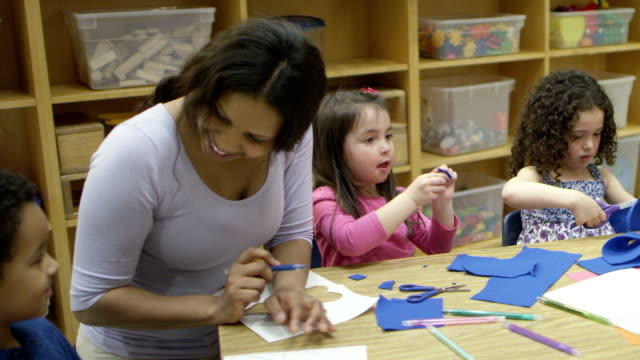 Preschool Art Time A multi-ethnic group of preschool children sitting at a table with art supplies, practicing freedom of expression. child care stock videos & royalty-free footage