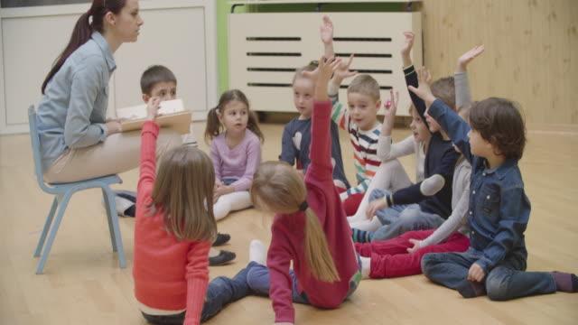 4K: Preschool teacher reading book to children video