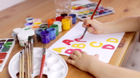 Preschooler learn how to write letters. Education concept A little child's hand writes a gouache. Preschooler learn how to write letters art and craft stock videos & royalty-free footage