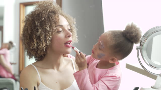 preschooler putting make-up on mother  lipstick stock videos & royalty-free footage