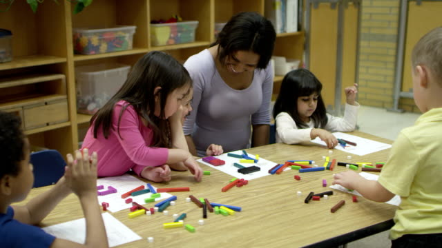 Preschoolers learning while at daycare. video