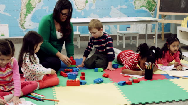 Preschoolers playing with blocks at a daycare center video