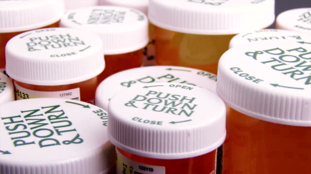 Prescription Bottles Slider shot of many prescription bottles, close-up pill bottle stock videos & royalty-free footage