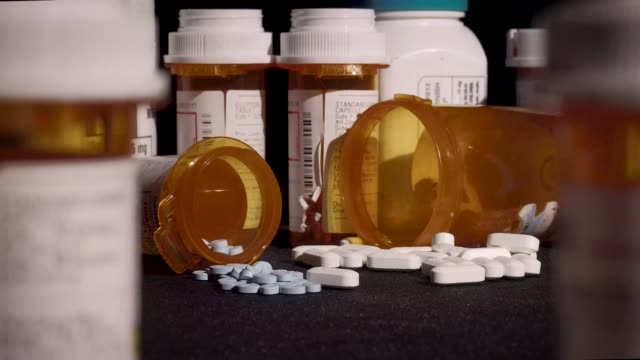 Prescription Medication Prescription medication is strewn out amongst other bottles. pill bottle stock videos & royalty-free footage