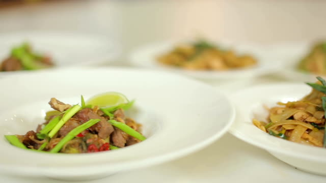 Presentation of a delicious dinner. Risotto, pasta and stewed pork with vegetables
