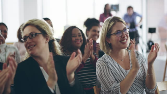 Presentations that inspire passion 4k video footage of an audience of happy people clapping at a business conference group of people stock videos & royalty-free footage