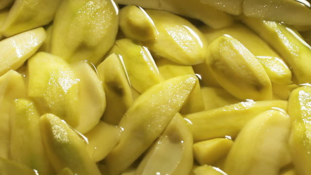 Preserved Mangoes Preserved Mangoes fruit for eating. Yellow mangoes. pickle stock videos & royalty-free footage