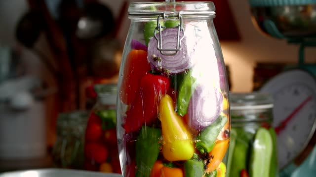 Preserving Organic Colored Red Bell Peppers in Jars Preserving Organic Colored Red Bell Peppers in Jars pickle stock videos & royalty-free footage