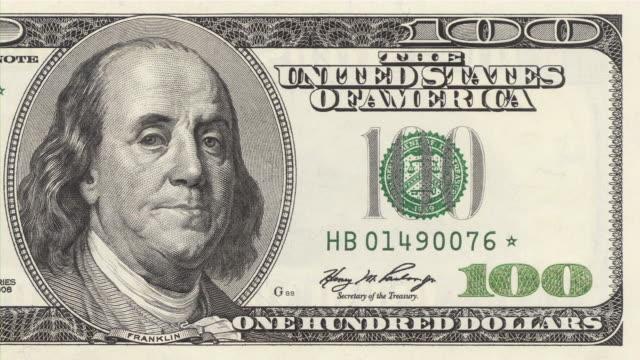 vídeos de stock e filmes b-roll de presidente franklin dar-a-wink de $100 dólares americanos. moeda. finanças. dinheiro. - piscar