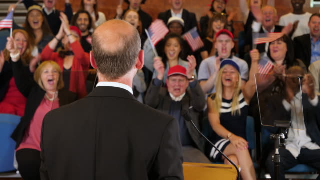 4K: USA Presidential campaign rally - Election Candidate speaks to supporters in Auditorium