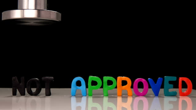 press presses inscription not from plasticine and it turns out the word is approved in different colors press presses inscription not from plasticine and it turns out the word is approved in different colors FullHD representing stock videos & royalty-free footage