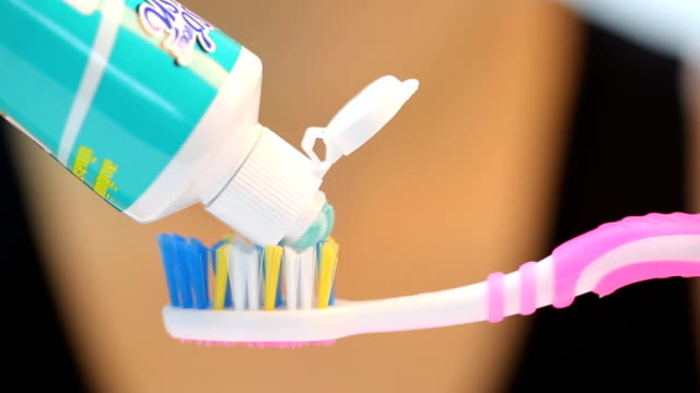 Press toothpaste to toothbrush for brushing your tooth video