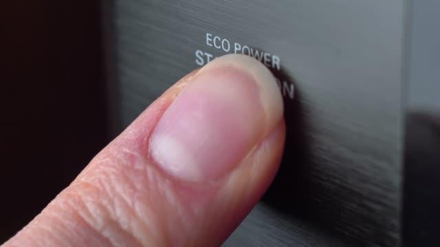 pressing stand by power button close-up - zasilanie elektryczne filmów i materiałów b-roll