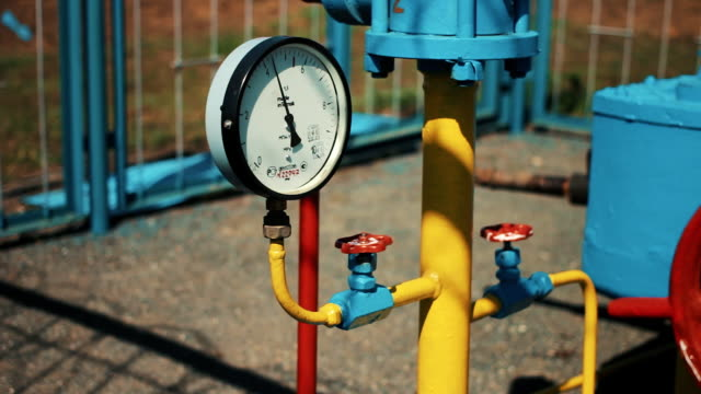 Pressure gauge on the gas pipe. A station for cleaning and storing natural gas. Oil and gas industry. Gas plant. Production of fuel. Storage tank video