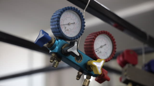 Pressure gauges suspended and ready for installation