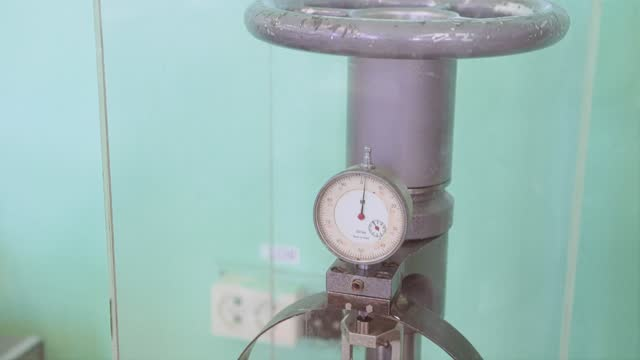 Pressure sensors on the pipe with a large valve. Shooting close-up