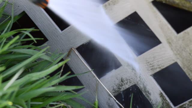 Pressure Washing Vinyl Lattice Fence Below Deck