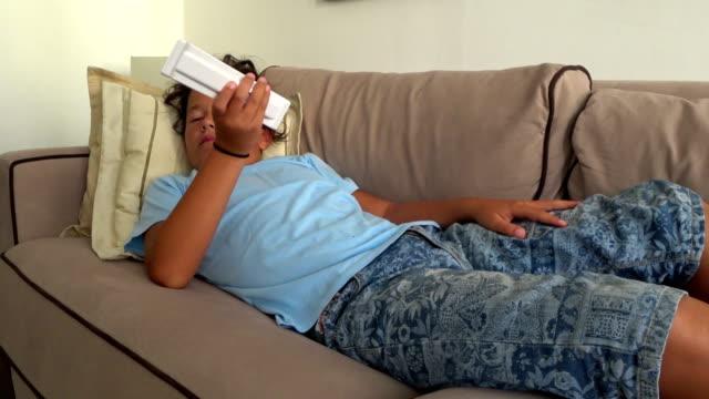 Preteen boy watching tv video