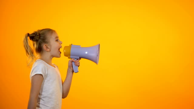 Preteen girl shouting in loudspeaker, releasing stress, making announcement Preteen girl shouting in loudspeaker, releasing stress, making announcement megaphone stock videos & royalty-free footage