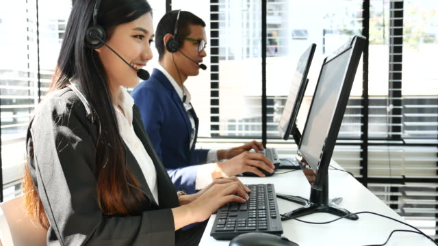 Pretty and customer service representative team working Pretty and customer service representative team working call centre videos stock videos & royalty-free footage