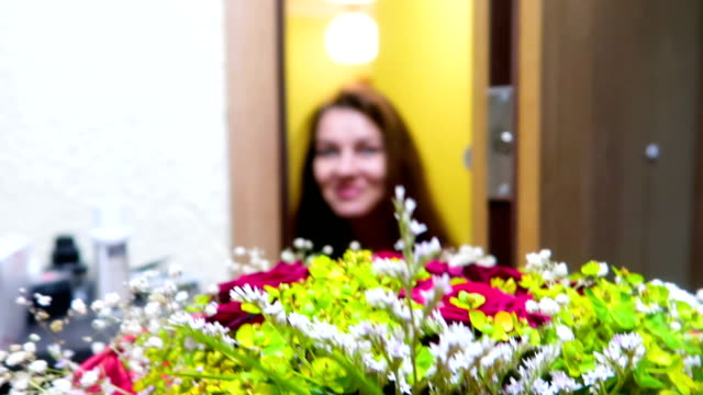 pretty beautiful woman receive / get a bouquet of flowers, surprise, present, smiling - ricevere video stock e b–roll
