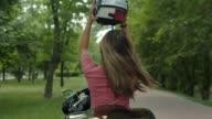 istock Pretty blond girl enjoying motorbike ride outdoor 1160381375