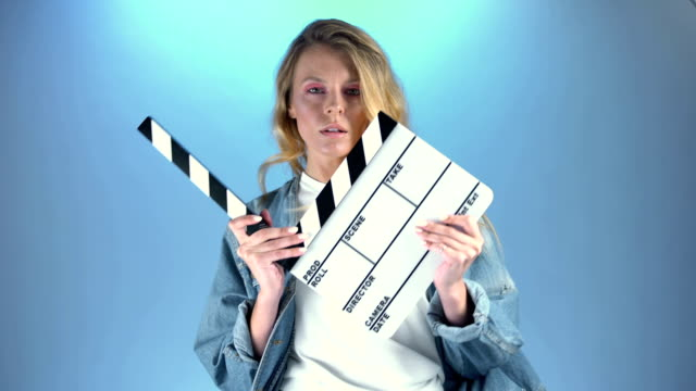 Pretty blonde actress posing for audition with movie clapper board, casting Pretty blonde actress posing for audition with movie clapper board, casting actor stock videos & royalty-free footage