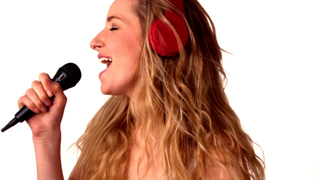 Pretty blonde listening to music and singing video