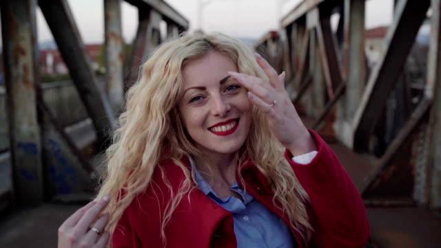 Pretty blonde on railway bridge