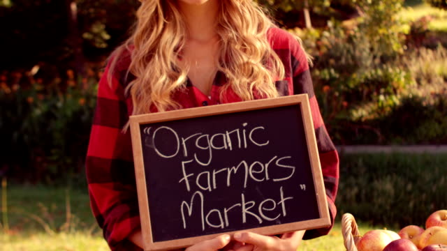 Pretty blonde selling organic vegetables at market video