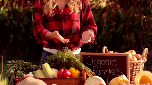 Pretty blonde selling organic vegetables video
