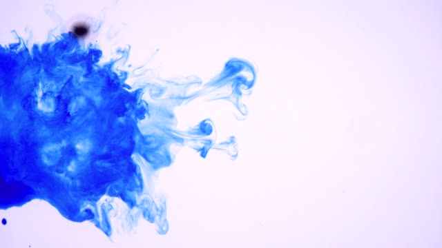 Pretty blue ink swirl on white background to use as reveal or transition video
