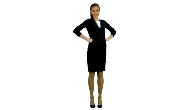 pretty businesswoman standing with hands on hips smiling at the camera on white background - mani sui fianchi video stock e b–roll
