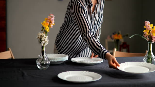 pretty caucasian woman setting up table for lunch - kitchen situations video stock e b–roll