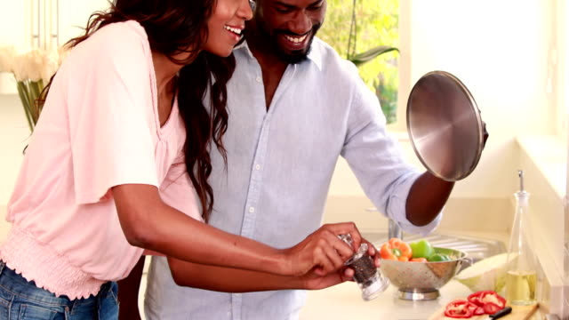 Pretty couple smiling and cooking video