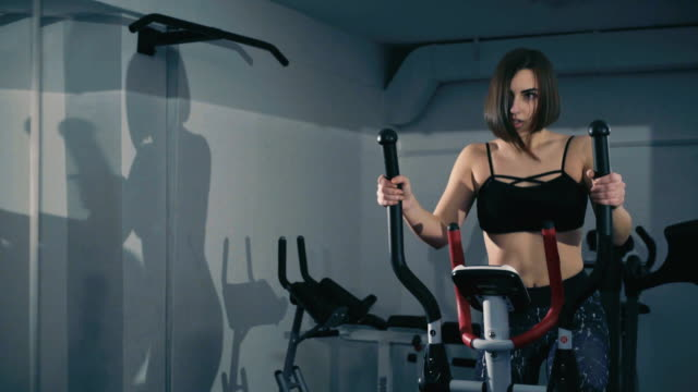 Pretty girl exercises on stepper in the gym in FullHD Pretty girl exercises on stepper in the gym in FullHD. human back stock videos & royalty-free footage
