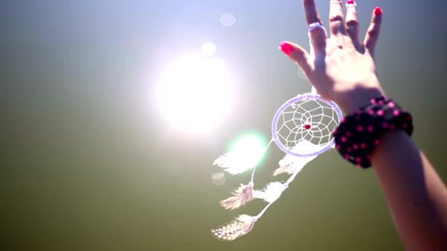 Pretty girl holding dream catcher in her hand video