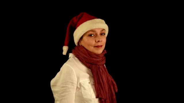 Pretty girl in red Christmas Santa hat smiles video
