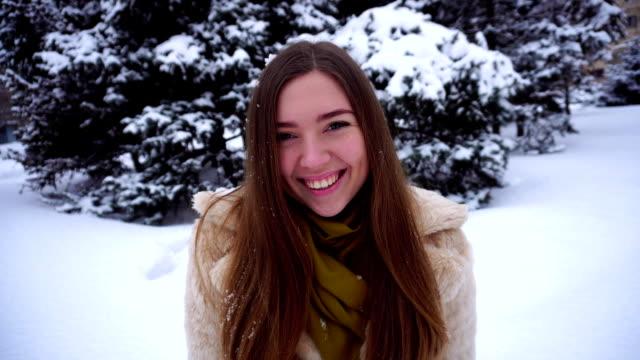 Pretty girl posing for camera winter snow video