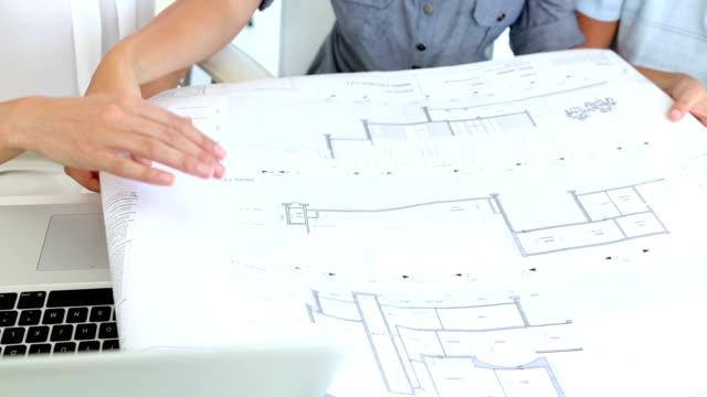 Pretty interior designer working with clients video