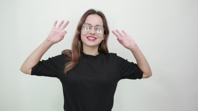 pretty lady with glasses closed her eyes focused on meditation, yoga exercise - mudra video stock e b–roll