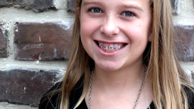 pretty little girl after braces video
