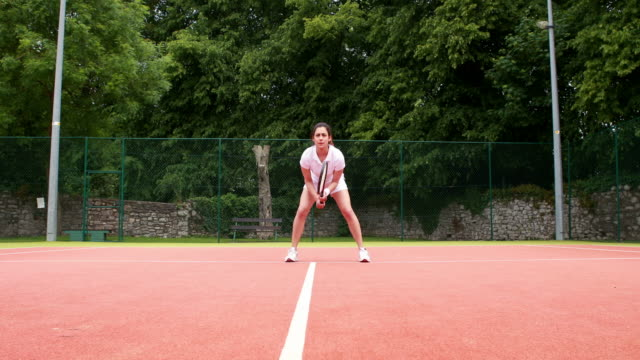 Pretty tennis player ready to play video