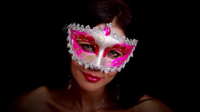 Pretty woman in a mask video