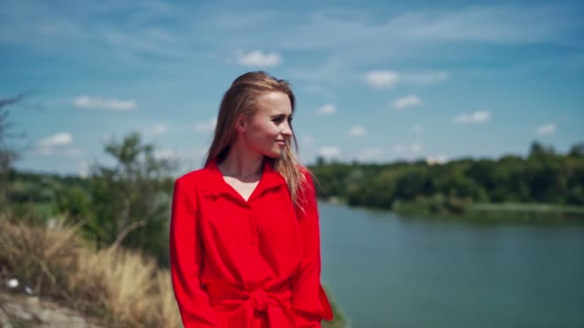 pretty woman in summer outdoors. - длина стоковые видео и кадры b-roll
